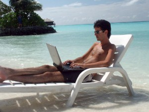 expat enjoying the sun and an old laptop